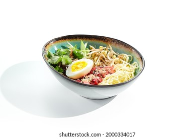 Ramen Chicken Soup - traditional soup with chicken and ramen noodles and other ingredients. Topped with eggs. Ramen soup bowl isolated on white background