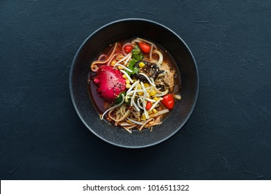 Ramen dish on dark background. Traditional Asian fast food meal. Delicious noodle soup