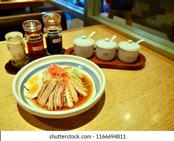 Ramen is a Japanese noodle dish. Seasoning in Thai & English Language is sugar, chili, pepper, chili oil, vinegar, and Gyoza Source.  Ingredient is shrimp, boiled egg, cucumber, pork, and  ramen.
