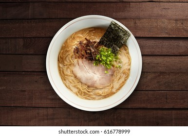 ramen japanese noodles with soup  top view on dark wood background