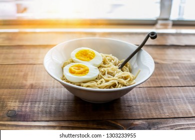 Ramen noodle with eggs and sunbeam from outside