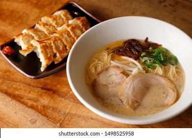 ramen noodle Japanese food ,dumpling jiaozi gyoza Chinese food Jananese food , a dumpling with minced pork and vegetable stuffing.