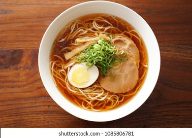 Ramen noodles in soy sauce flavored soup.