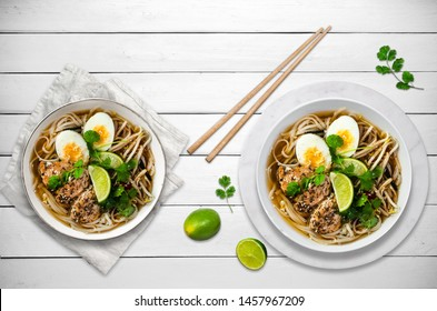Ramen soup with eggs, asian food background