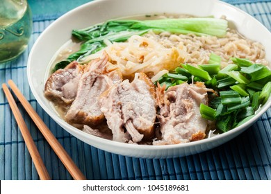 Ramen. Traditional japanese noodle soup with pork, green onion and pak choi cabbage