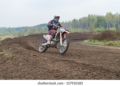 RAMENSKOYE, MOSCOW REGION, RUSSIA - OCTOBER 5: Riders in action during competition motocross in Ramenskoye on October 5, 2013.