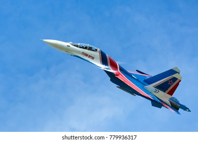 RAMENSKOYE, ZHUKOVSKY AIRPORT, MOSCOW, RUSSIA - JULY 22, 2017. Military aircraft Sukhoi SU-30SM of the aerobatic team Russian Knights performs a demonstration flight with aerobatics figures.