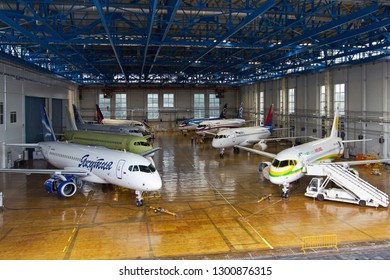 Ramenskoye (Zhukovsky), Moscow Region / Russia - 08.24.2013. Passenger aircrafts Sukhoi Superjet 100 of different airlines in different liveries. Hangar of Sukhoi Civil Aircraft Company.