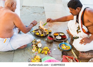 RAMESHWARAM, TAMIL NADU, INDIA- MARCH CIRCA, 2018. Unidentified indian pilgrim performing rituals Puja, with families, just before going to the temple.