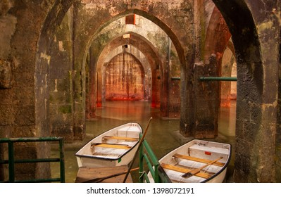 RAMLA, ISRAEL - APRIL 8, 2011: Rowboat at the underground Pool of Arches in Ramla. Israel. Pool built during the reign of the caliph Haroun al-Rashid in 789 AD