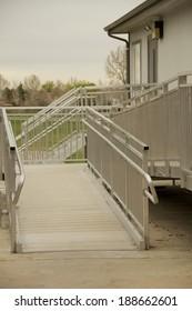 Ramp Access Metal wheelchair access ramp into a building.