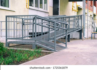Ramp for the disabled at the entrance to the entrance of a residential building