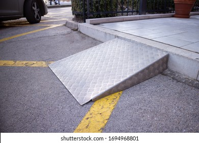 Ramp for disabled persons on wheelchair at building entrance.