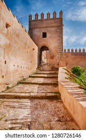 A ramp with steps leads upwards towards one of the guard towers that are located on the outside walls of the Kasbah in Rabat, Morocco.