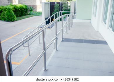 ramp way for support wheelchair disabled people.Using wheelchair ramp (Barrier-free access).Selective focus.