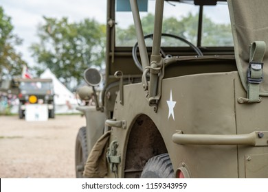Ramsey, Cambridgeshire, UK - Circa August 2018: Shallow focus, isolated image of a WW2 US Army jeep, seen having been restored. The painted star and steering can be seen on this iconic vehicle.