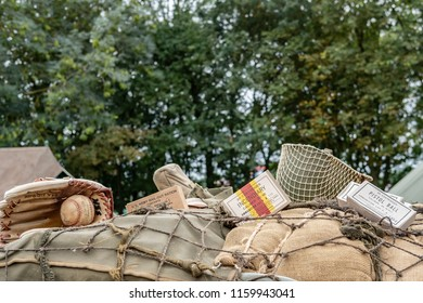 Ramsey, Cambridgeshire, UK - Circa August 2018:  Close-up image of iconic WW2 US Army helmet, ammo, rations and an iconic baseball glove seen on a makeshift sandbag fortification at a WW2 location.