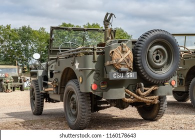 Ramsey, Cambridgeshire, UK - Circa August 2018: Detailed view of a restored US Army WW2 Jeep seen complete with luggage and a tow rope. Part of a show of military vehicles seen in an outside locale.