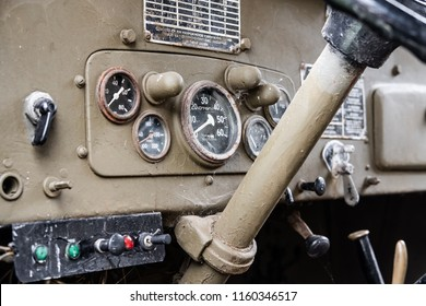 Ramsey, Cambridgeshire, UK - Circa August 2018: Interior view of a WW2 US Army jeep show its various dials and steering column. The hand brake can be just seen on the far right of the image.