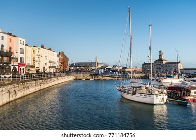 RAMSGATE, ENGLAND - NOV 23 2017.  Buildings  and boats in and around the marina in the winter evening sunshine. The town has one of the largest marinas on the English  south coast.