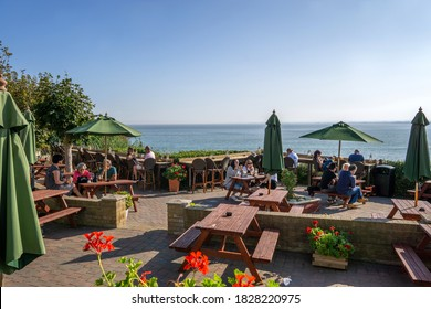 Ramsgate / UK - 21 September 2020: Outdoor beer garden terrace at Belle Vue Tavern pub in Pegwell Village with ocean views