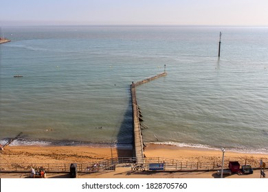 Ramsgate / UK - 21 September 2020: Sandy beach, sea wall and ocean in Ramsgate, Kent
