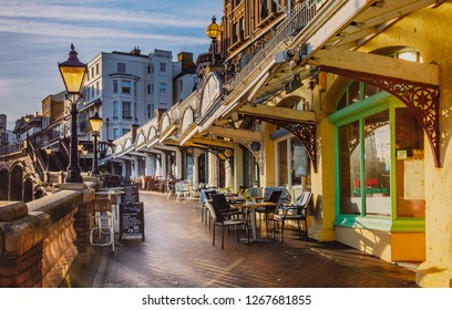 Ramsgate, UK - Dec 24 2018. The low afternoon sun illuminates the cafes and restaurants along the West Cliff arcade which overlooks the Royal Harbour and sea on a quiet but sunny Christmas Eve.