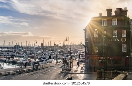 Ramsgate, UK - Jan 22 2018.  The late afternoon sun behind a large public house in the impressive and historic Royal Harbour of Ramsgate. Given its royal status by King George IV