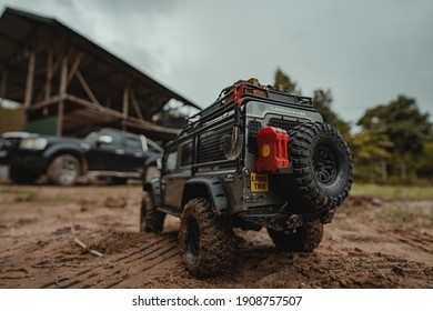 RANAU,SABAH-10 3 2021: closeup view of the back black car toy on the mud ground with blurred background and noise effect