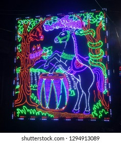 """Ranchi, Jharkhand/India-January 26 2019: This pic shows the light decoration from a Durga Puja pandal.It shows a horse playing drums, with its forelimbs, because it's happy for the Goddess' arrival."""