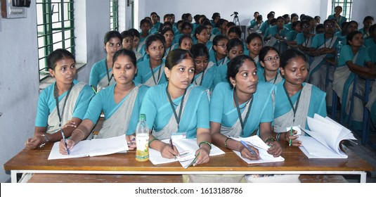 Ranchi,Jharkhand / India - November 5 2019: Group of Indian B. Ed College  girls students in uniform studying hard from books in the classroom of their College. Inside class room. Kanya Vidyalaya.