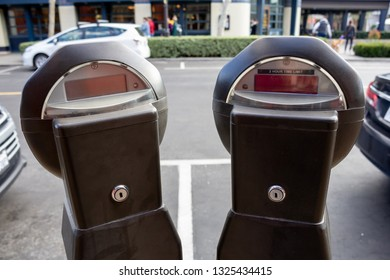 Rancho Cucamonga, California/United States - 2/22/19: A pair of parking meters on a street at a mall