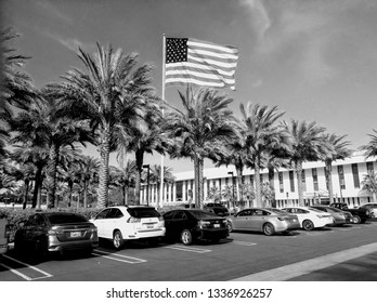 Rancho Mirage, California - March 4, 2019:  FLAG AND PALM TREES. A giant American flag flies over the Eisenhower Medical Center.