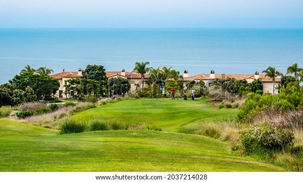 Rancho Palos Verdes, California - July 26, 2021: Two men play a round of golf at the Links at Terranea, at the Terranea Resort Hotel in Rancho Palos Verdes.