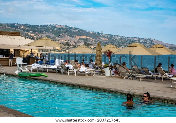 Rancho Palos Verdes, California - July 25, 2021: People enjoy the pool overlooking the cliffs of the Pacific Ocean at the Terranea Resort Hotel, in southern California.