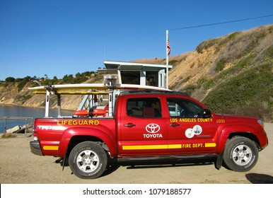 Rancho Palos Verdes, California USA - January 31, 2018: A Los Angeles County lifeguard truck in front of a classic lifeguard station on the beach at Abalone Cove Shoreline Park on the Pacific Ocean.