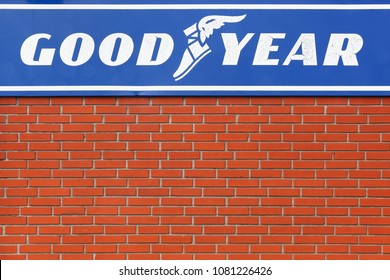 Randers, Denmark - March 13, 2016: Goodyear logo on a wall. Goodyear is an American multinational tire manufacturing company founded in 1898 by Frank Seiberling and based in Akron, Ohio