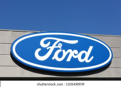 Randers, Denmark - May 5, 2018: Ford logo on a wall. Ford is an American multinational automaker headquartered in Dearborn, Michigan, USA