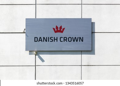 Randers, Denmark - May 5, 2018: Danish Crown logo on a wall. Danish Crown is a Danish food processing company, dealing primarily in meat processing of pork and beef