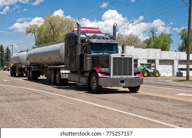 Randolph, United States - June 02, 2015: Peterbilt truck with double tank crosses a small city in Utah.  The Denton Texas USA based Peterbilt Motors Company was founded in 1939 and manufactors heavy d