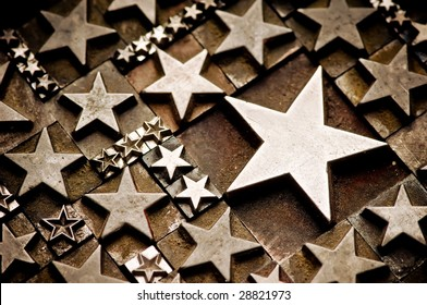 A random arrangement of letterpress stars with narrow depth of field, tinted Sepia tone.