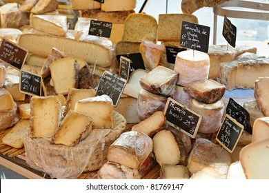 Random French cheese at rural Provence market, town of Aix-en-Provence
