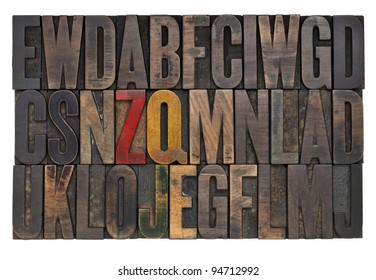 random letters of alphabet abstract - vintage wood letterpress printing blocks with ink patina