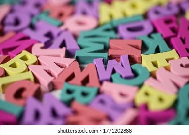Random letters scattered in Pastel