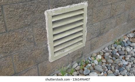 A random louver of a brick building's exterior wall. Photo taken in Richmond, BC, Canada.