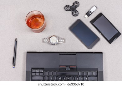 Random office items on table background, notepad, smartphone, pendrive, notepad