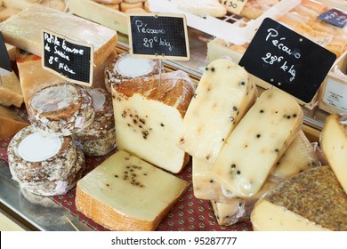 Random sorts of traditional French cheese for sale on Provence market, France