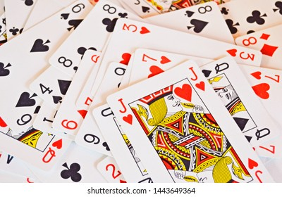 Randomly distributed playing cards with no background
