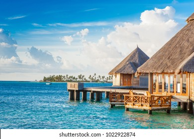 Rangali, Maldives island - 16 June 2017: Beautiful tropical sunset landscape with wooden villas over water of the Indian Ocean, Maldives island, 16 June 2017