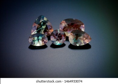 The range of color, that is found in sunstones, is seen in each of these individual gemstones in the group photos. Round, oval, triangle and pair shape stones of bicolored sunstones.